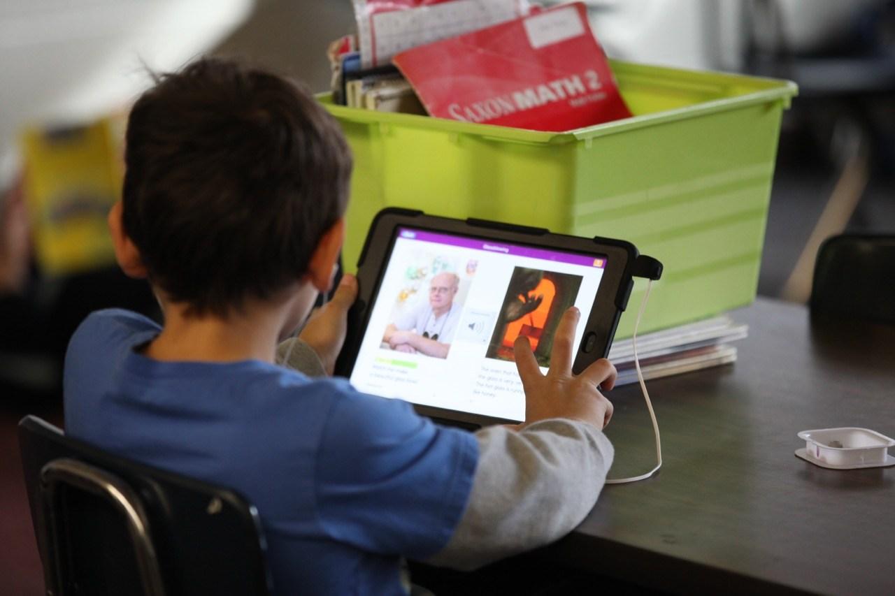 student studying on ipad