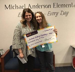 STCU Winner Ms. Overhauser holding a $250 check