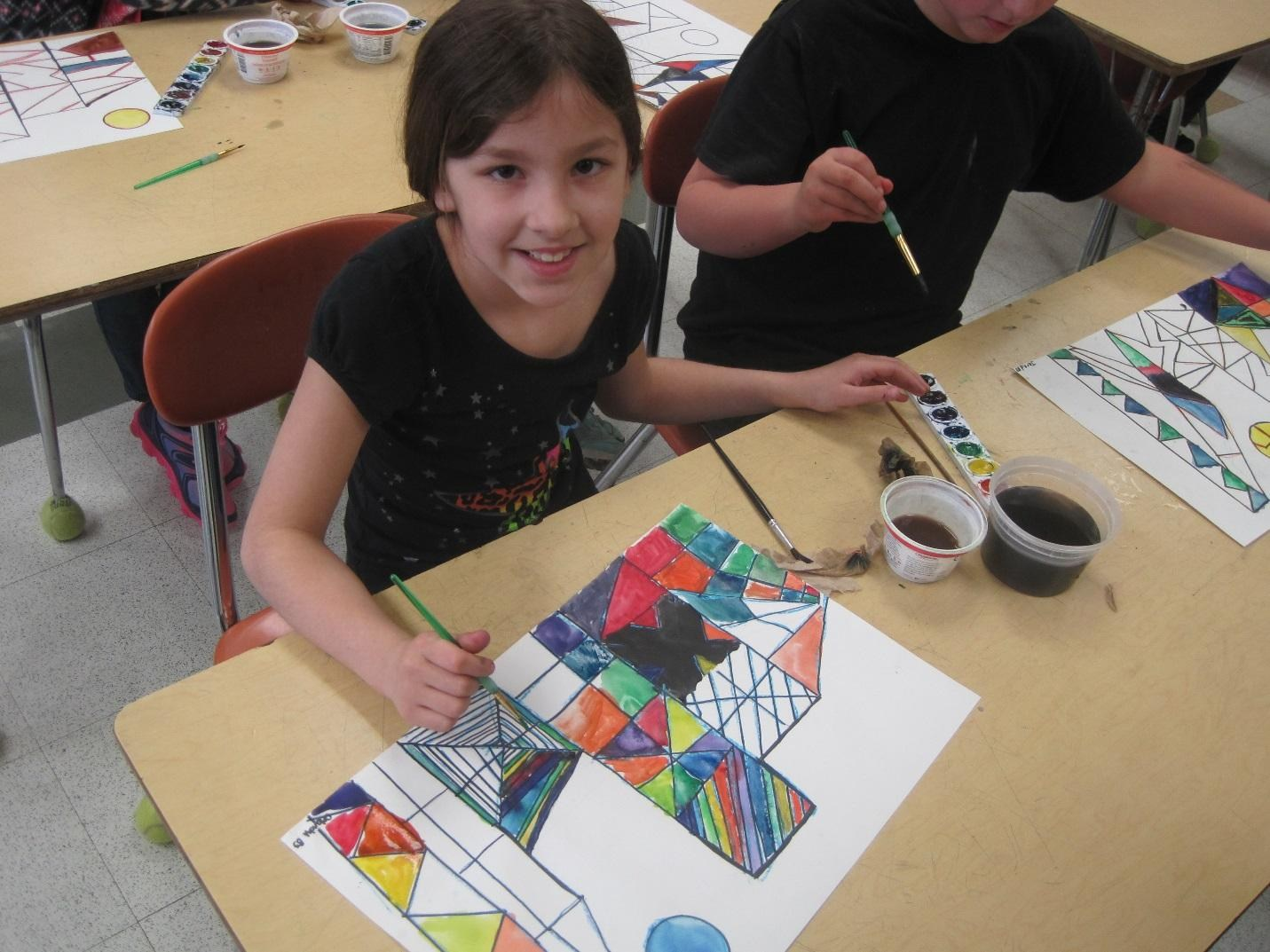 Elementary student hard at work in art class
