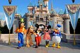 Image of Cinderella's castle at Disneyland with Mickey, Minnie, Goofy, Pluto, and Donald Duck.