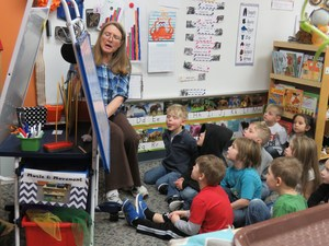 Thornapple Kellogg preschool students listen to a story before lunch.