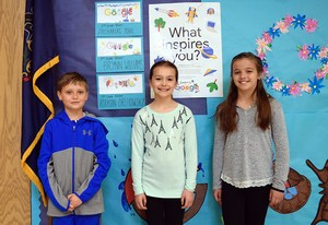 Three students posing for a photo.
