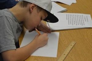 OC student writing poetry