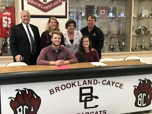 Nathan Walton and Madison Conwell, with their parents.