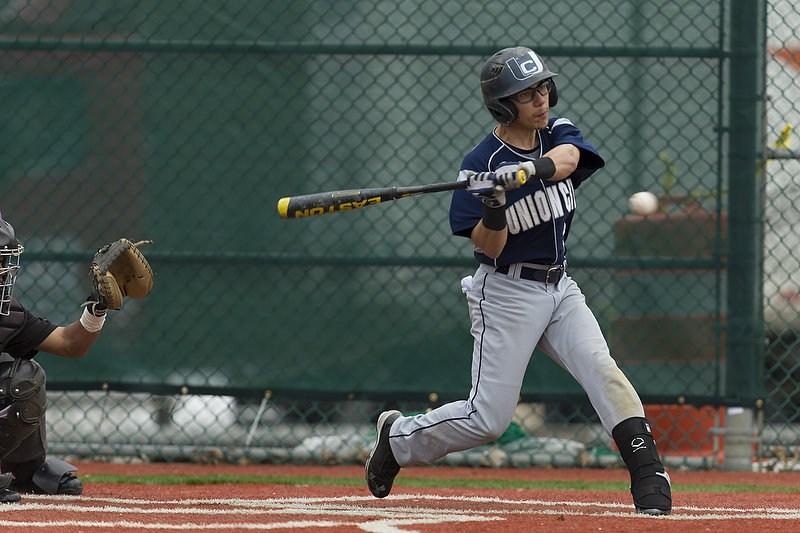 baseball player hitting a pitch