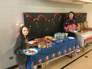 Students with snacks at the dance party