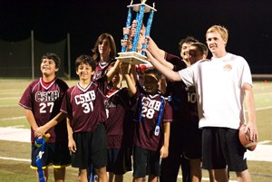 Boys sports team holding a trophy