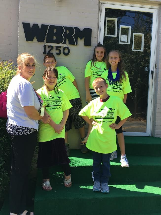 Mrs. Dowdle visits WBRM radio station with our news team from Glenwood