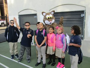 kids welcome other students with the school's jaguar mascott
