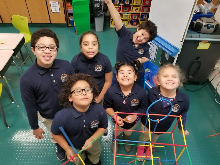 children proudly posing with their hexagon
