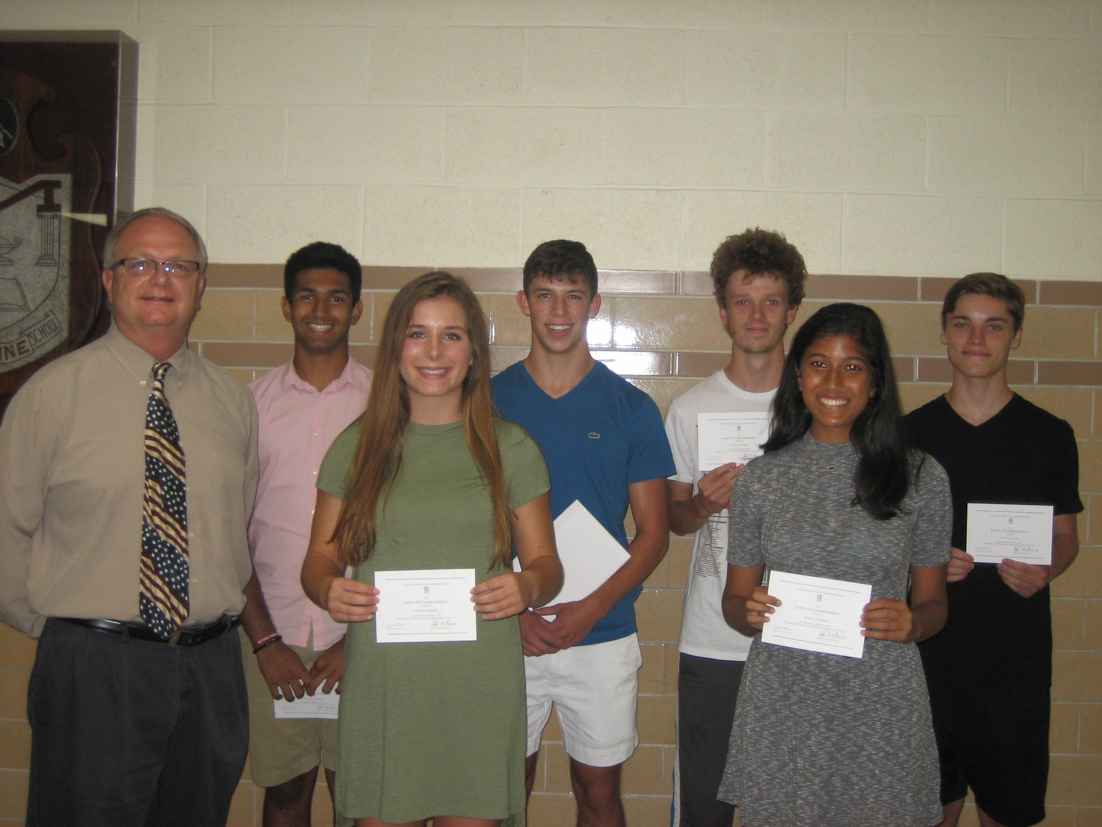 Photo of MHS students who received merit scholarship recognition.
