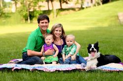 Picture of Mrs. DeNu, her husband Paul DeNu, and children Sophie and Hayden and their dog Izzy