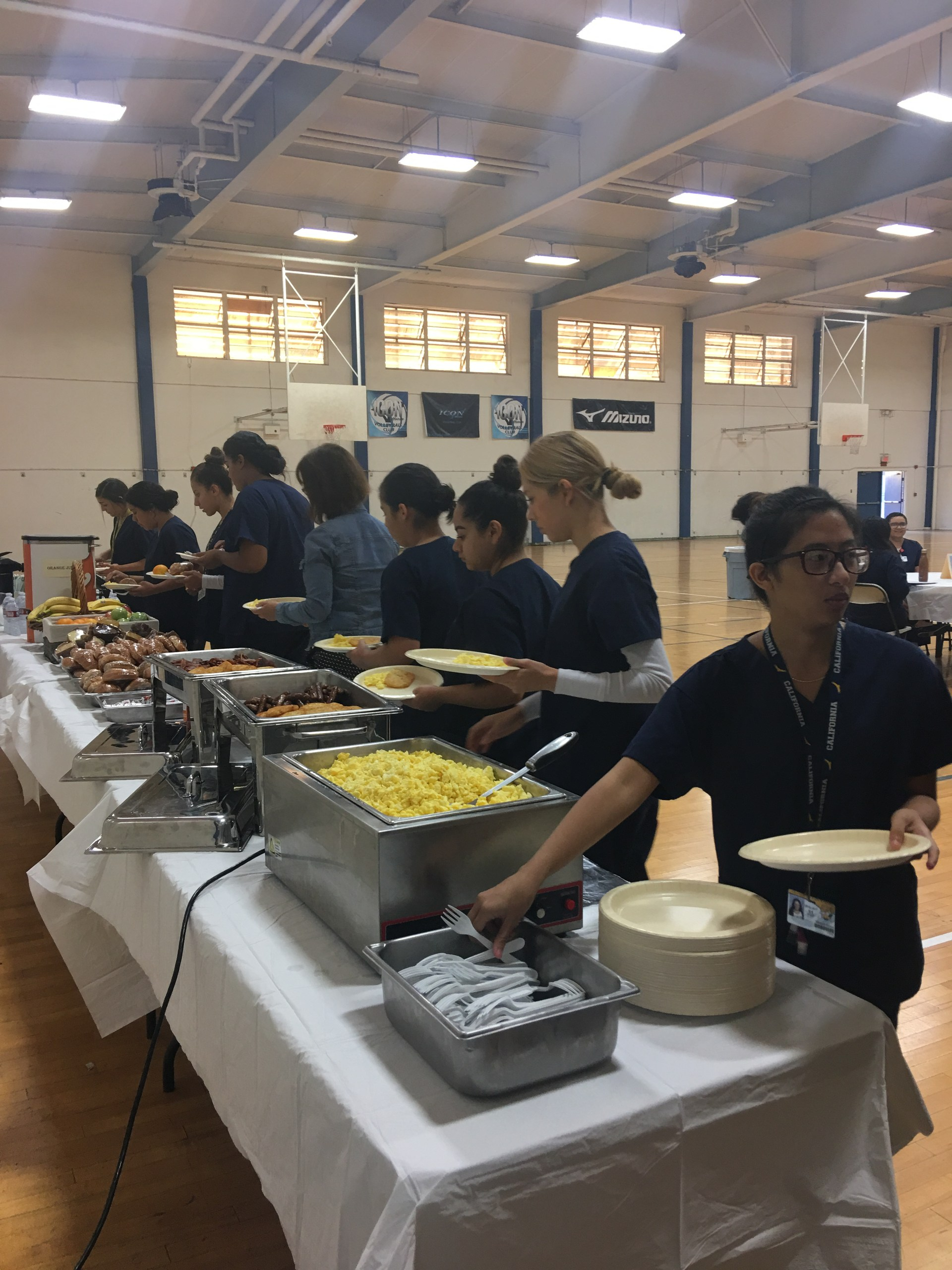 Health Academy students being served breakfast