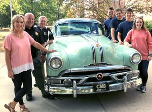 Left, Central Magnet School Car Club sponsors Jenny Culp, Scott Culp and Michael Ruess, along with club members MaryGrace Bouldin, Chris Johnson, Matthew Connors and Hunter Jones, showcase the 1953 Pontiac Chieftan that will be used by students in next summer's The Great Race. The Central team will be the first high school group from Tennessee to participate in the cross-country event.
