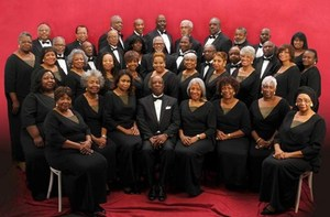 A photo of the elegant Heritage choral ensemble dressed in black and white