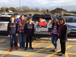 Student council loading up canned goods