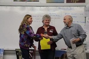 Mary Kay Stewart and Rob Dawes present Anna Caplan with the $2,000 Newbold Family Scholarship.