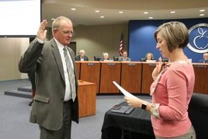 Robert Davis being sworn in by Superintendent Barrett.