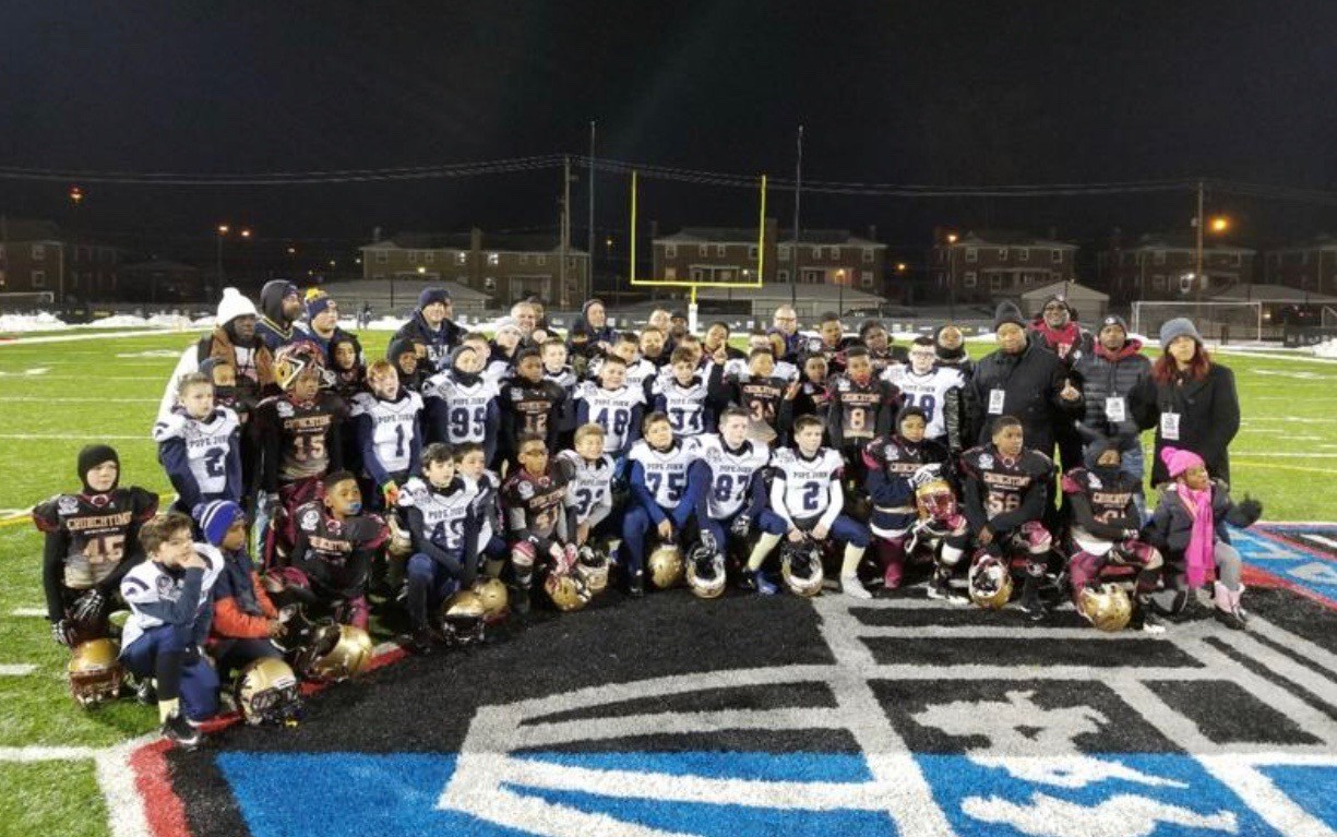 Jr Lions 10U Football team poses after playing in national semifinal game