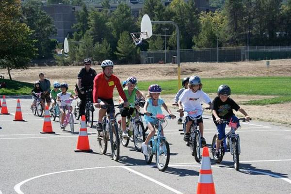 Park students riding bikes.