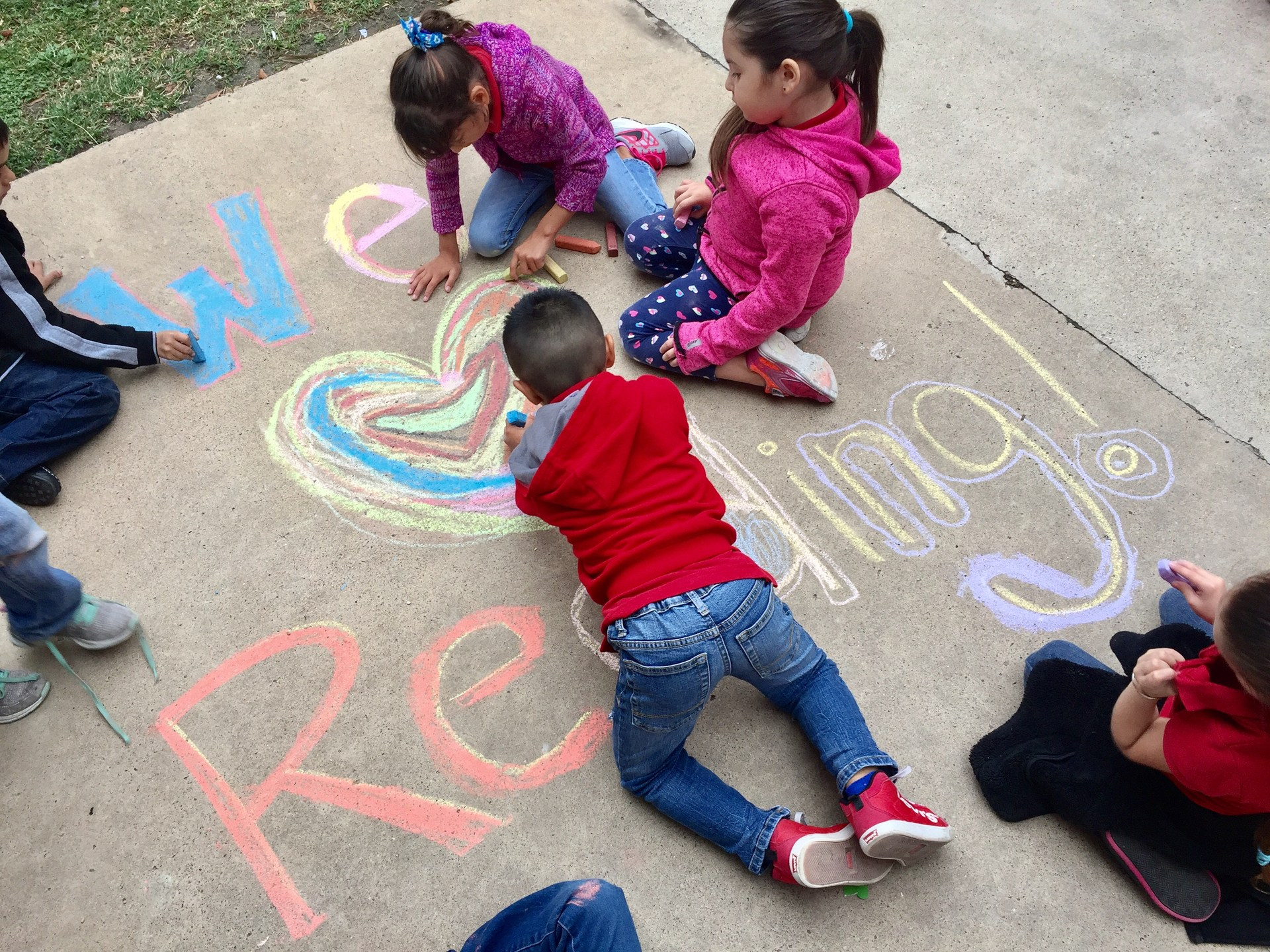 First grade chalk art shows they love reading.