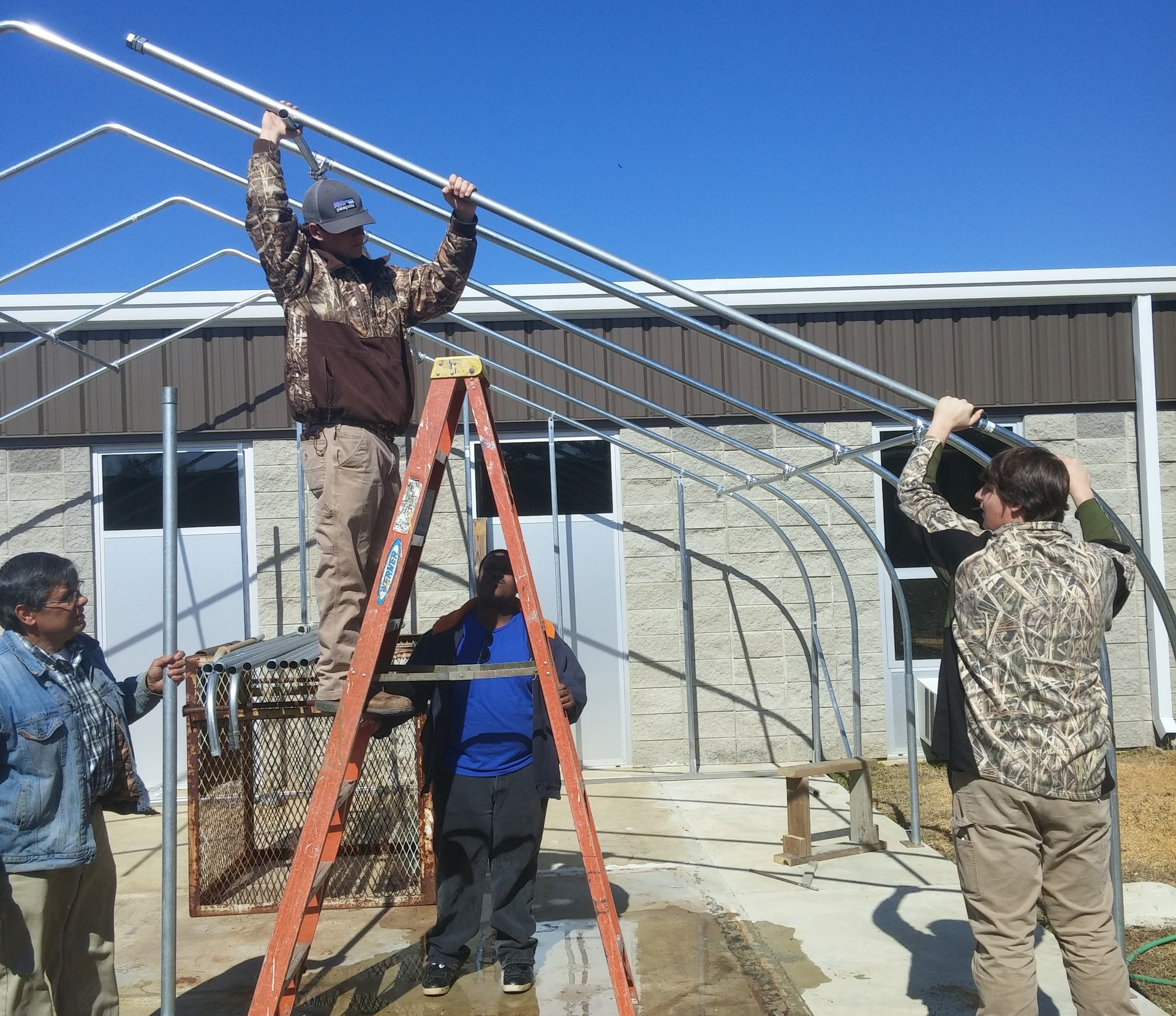 Agriscience student building greenhouse.