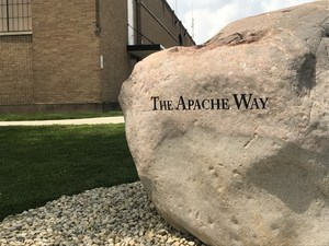 Rock with The Apache Way engraved.