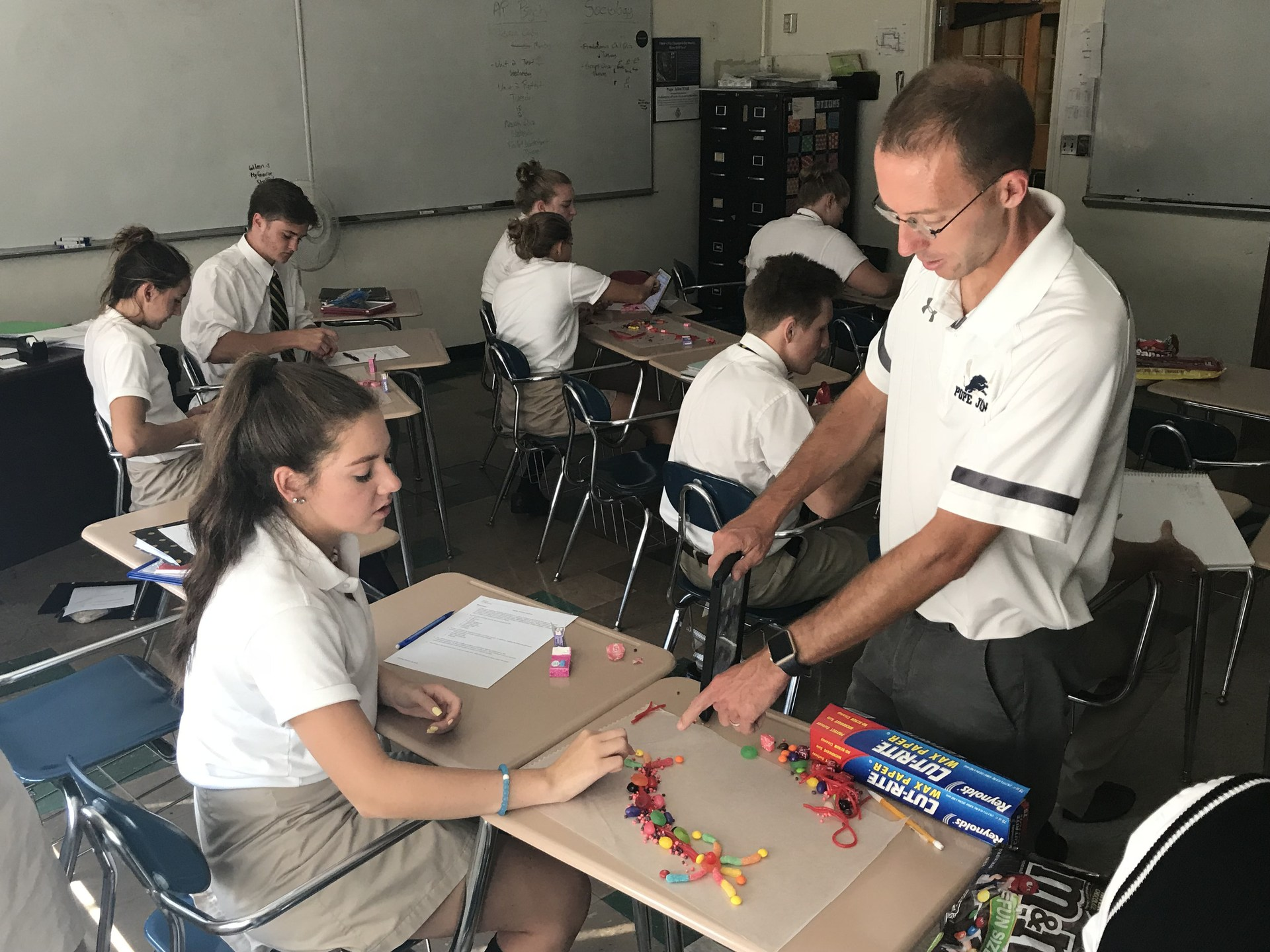 Teacher helping student understand neurons