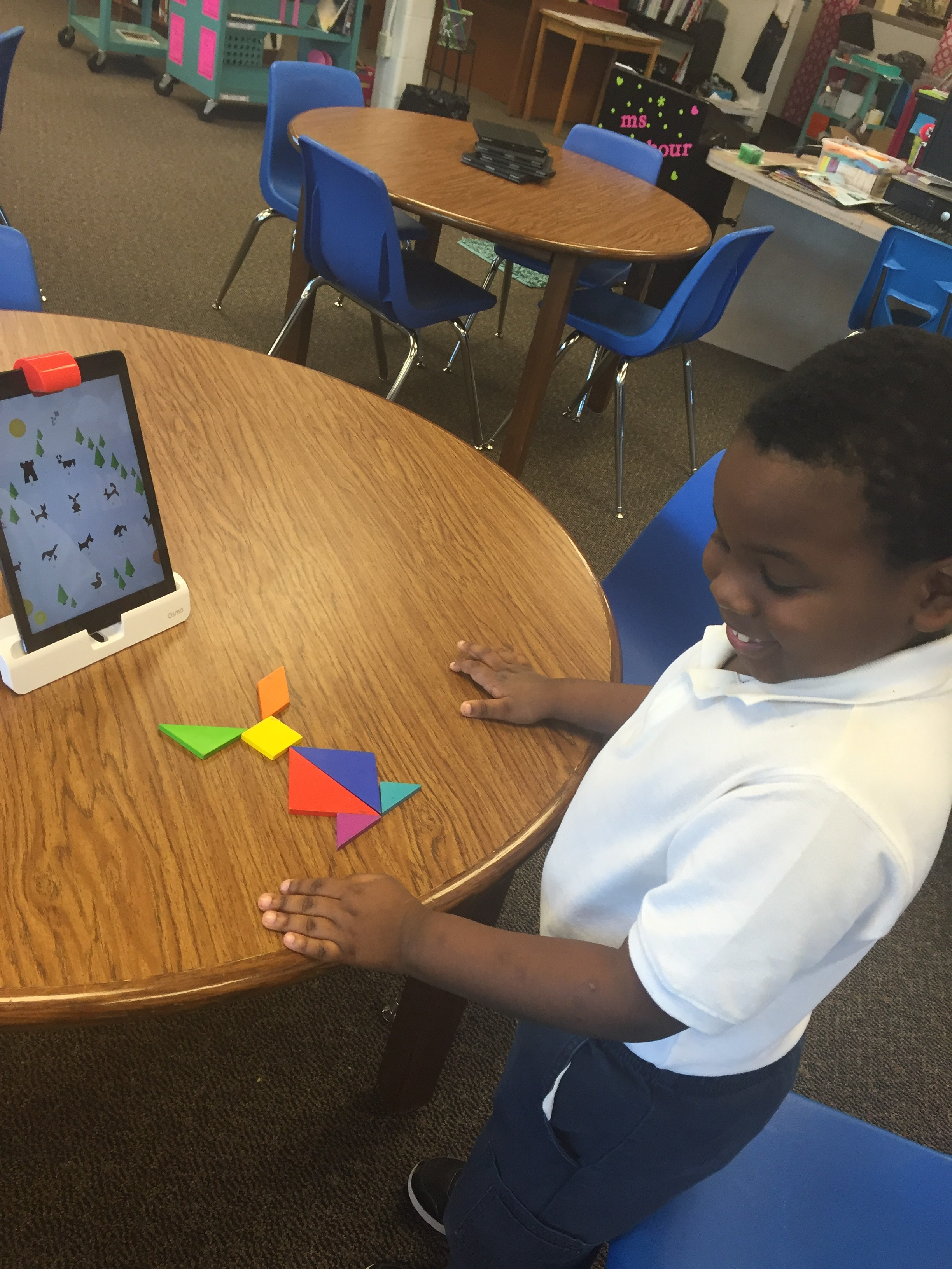 boy showing work with Ipad and tangleo's