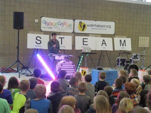 Musician Kevin DePree demonstrates how science, technology, engineering, arts and math work together.