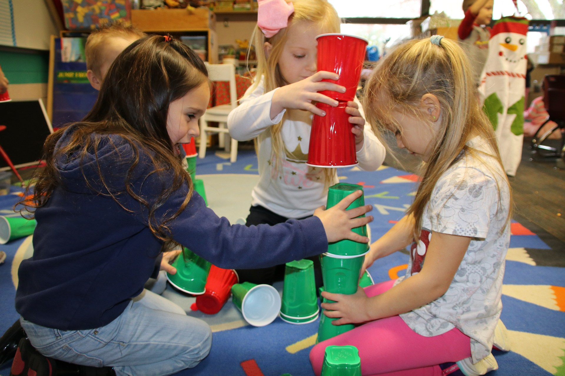 preschool girls stacking cups