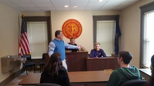 Gannon professor Dr. Gerald Clark shows the students a mock courtroom