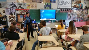 Trooper Dianna Wamsher visits Dennis Twp 8th graders.jpg