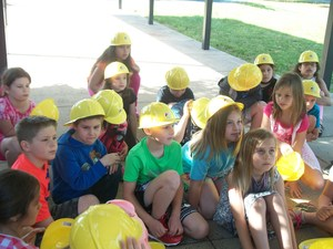 Second grade students view large equipment used by Lexington Utilities Natural Gas.