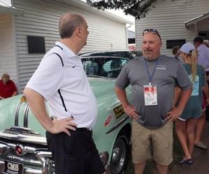 Central Magnet principal Dr. John Ash and car driver, SRO Scott Culp discuss the race