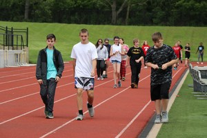 Students walk around the track.