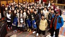 Band and Orchestra students group shot with trophies