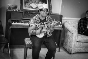 Monique Sarzoza playing guitar