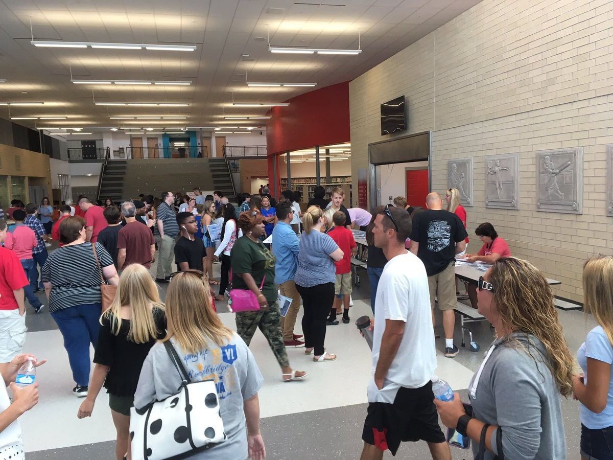 Freshman School Students finding their way at schedule pick up in the new building.