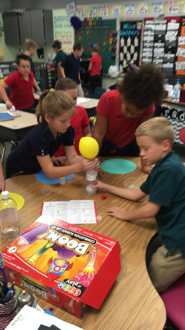 students creating a science experiment