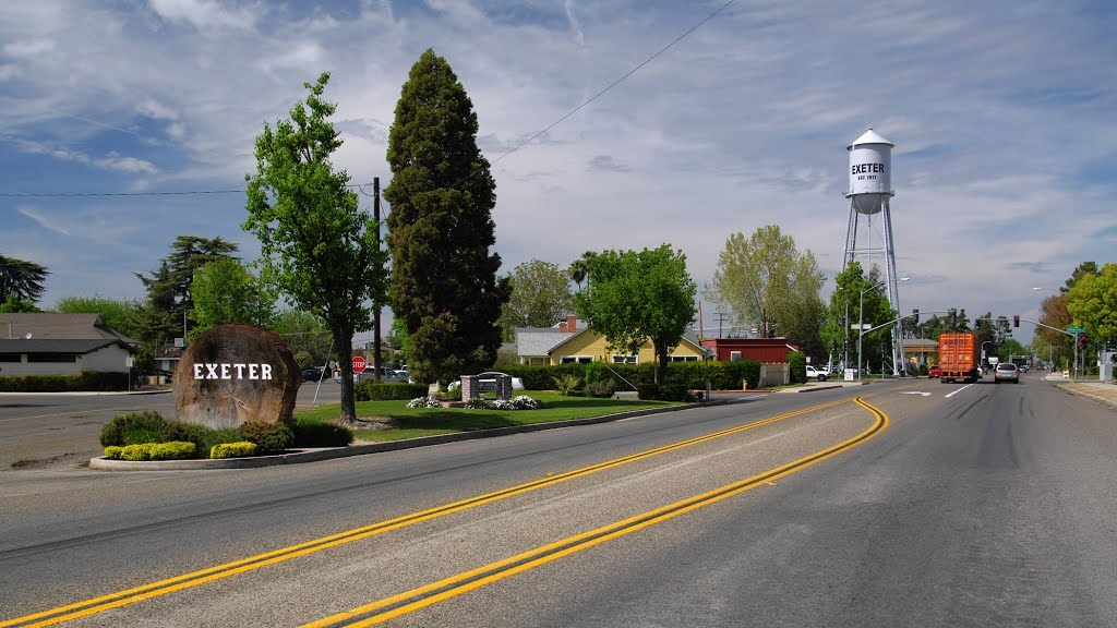 city of exeter with large log and water tower