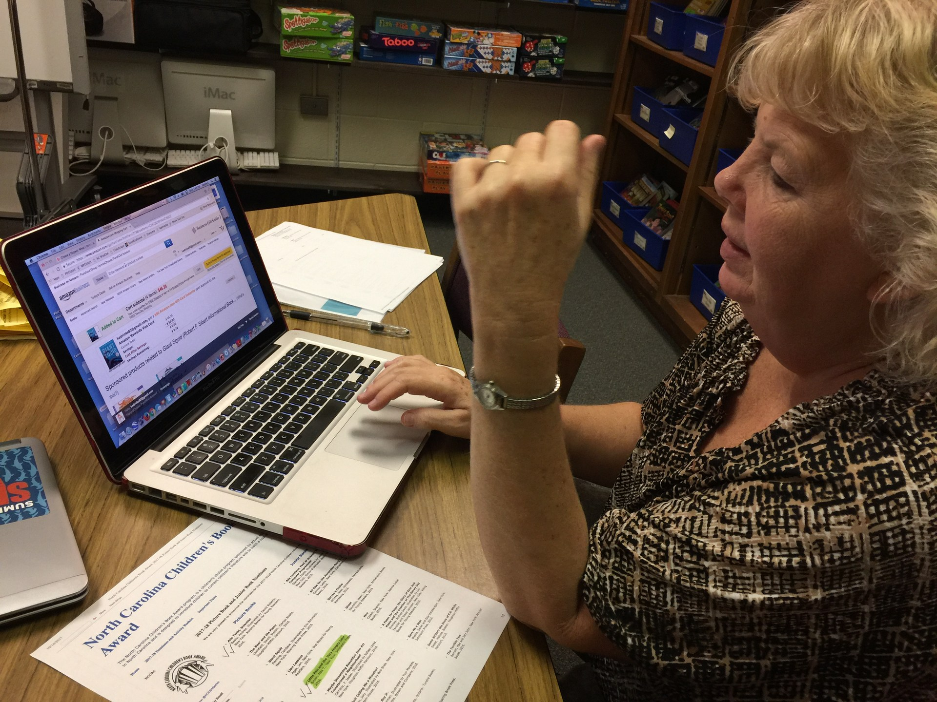 SLMC Carol Hedrick working on digital resources.