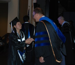 Student accepts diploma, GCAA Class of 2016