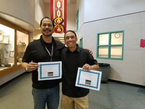 Escalante teachers John Hise and Rob Javier hold certificates of recognition from National History Day of Colorado.