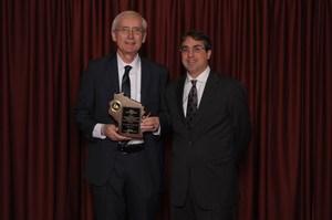 Principal accepting award