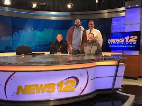 Self-advocates and Rich Hoffman at News 12 studio