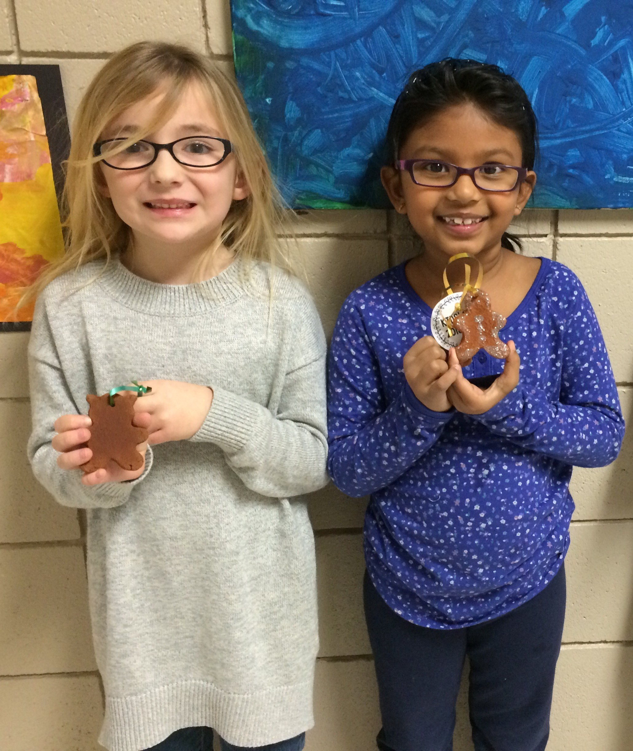Showing their hand-made ornaments.