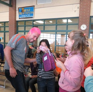 TKMS principal Brian Balding dyed his hair pink after students met a reading challenge.