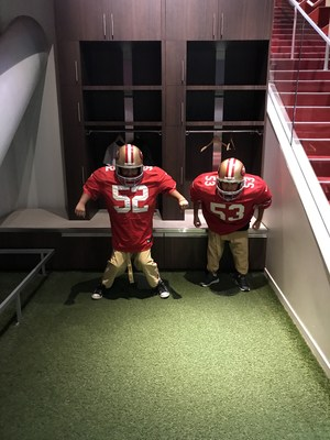 Two students dress in football uniforms