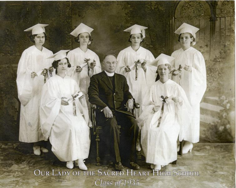 The six young women who graduated from OLSH in 1935 pictured with a priest from the school